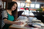 Poet's Pen organizer Molly Wood sits at the Wine Loft in downtown Flagstaff, which hosts her popular weekly event.