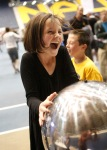 Zoe Rucker, 10, touches a static charged ball which causes her hair to stand on end during the second-annual Flagstaff Community STEM Celebration at the Skydome Wednesday evening.