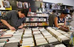 Kaleb Lightfood, left, and Rowan Mitchell St-John, right, dig through the stacks of comic books at Cab Comics during Free Comic Book Day celebrations Saturday.