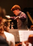 Flagstaff High School student Ben Vining conducts the school orchestra during rehearsals for their winter concert.