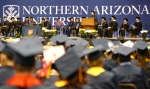 Students listen as Northern Arizona University President Rita Cheng makes an address during commencement at the Walkup Skydome Friday morning.