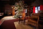 A large fir tree trimmed with ornaments made by fourth graders at the San Francisco de Asis School stands in the common room of the Riordan Mansion. The historic home will be decorated for Christmas as it would have been 100-years-ago through January 4, 2016 with tours begining on the hour Thursdays through Mondays.