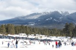 Thousands of people crowd into the Wing Mountain Snow Play area Tuesday afternoon.
